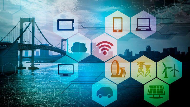 Symbole zu Technologien, Vernetzung und Energie in Wabenmuster vor einer Hängebrücke