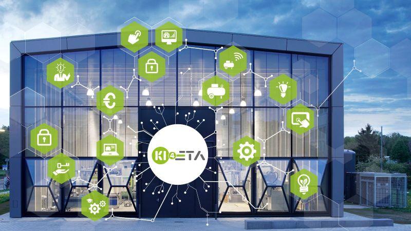 Die ETA-Fabrik der TU Darmstadt ist hinter einer Grafik zum Thema künstliche Intelligenz zu sehen.
